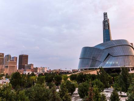 Winnipeg skyline with the Canadian Museum for Human Rights at sunset