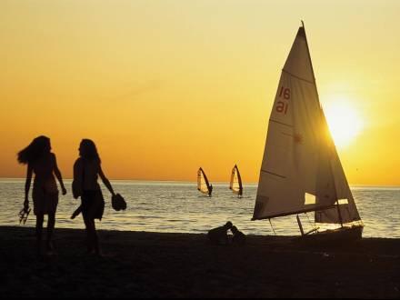 Sailboats at Gimli beach at sunset